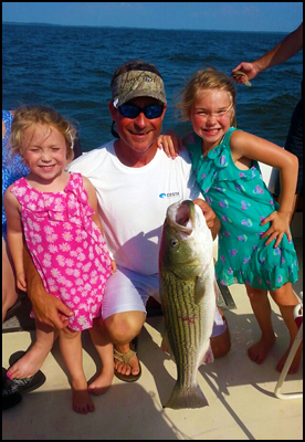 Captain Chuck and daughters